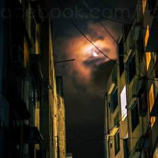 """While coming back home the other day, I saw the moon between the two buildings with clouds, and I set up my camera there and waited for half an hour there only. Even though this was a few steps away from home, I was actually a bit scared to lose my camera there."" By: Fazz Kazi."