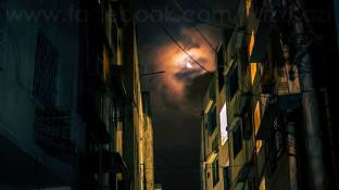 """""""While coming back home the other day, I saw the moon between the two buildings with clouds, and I set up my camera there and waited for half an hour there only. Even though this was a few steps away from home, I was actually a bit scared to lose my camera there."""" By: Fazz Kazi."""